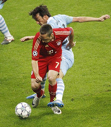 Bayern Munich's Franck Ribery (left) is tackled by Manchester City's David Silva