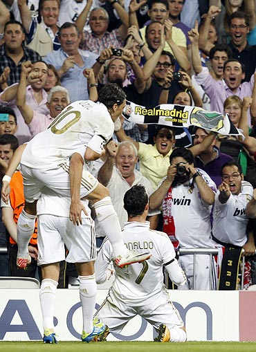Real Madrid's Cristiano Ronaldo celebrates his goal against Ajax Amsterdam in front of the crowd