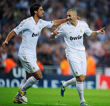 Real Madrid's Karim Benzema (right) celebrates with Sami Khedira after scoring against Ajax