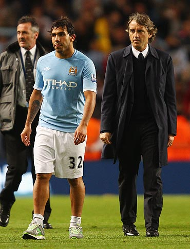 Carlos Tevez with Manchester City coach Roberto Mancini