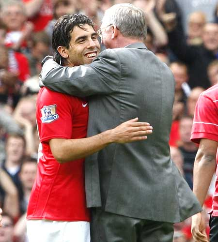 Carlos Tevez with Manchester United coach Alex Ferguson