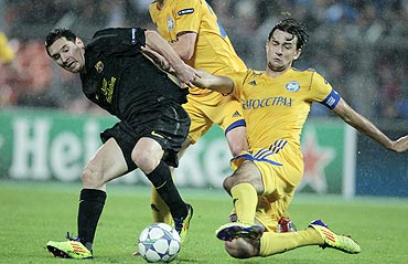 Bate Borisov's Yegor Filipenko (right) and Barcelona's Lionel Messi vie for possession during their Champions League match on Wednesday