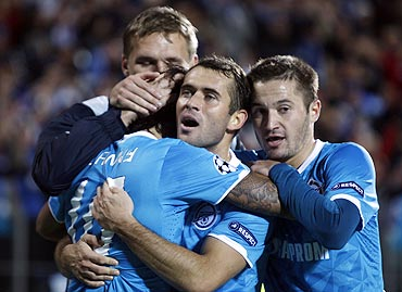 Zenit St. Petersburg's players congratulate teammate Danny (left, foreground) after scoring against Porto