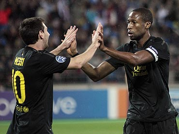 Barcelona's Lionel Messi (left) and Seydou Keita celebrate a goal