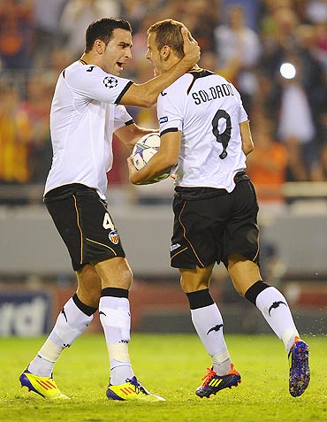 Roberto Soldado of Valencia celebrates with teammate Adil Rami (left) after scoring from the penalty spot