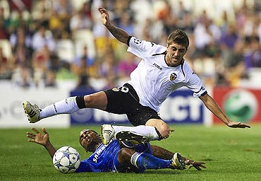 Valencia's Pablo Hernandez (right) is challenged by Chelsea's Florent Malouda