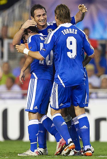 Frank Lampard celebrates with teammates after scoring against Valencia
