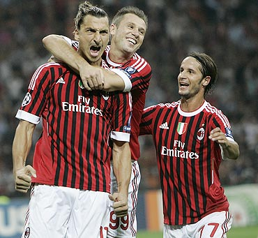 Zlatan Ibrahimovic (left) celebrates with teammates after scoring against Viktoria Plzen