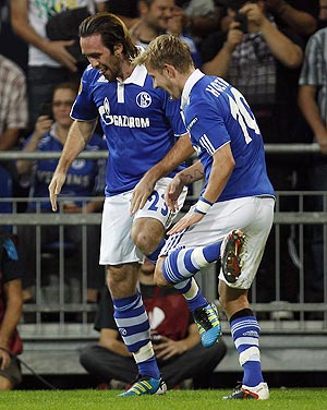 Schalke 04's Christian Fuchs and teammate Lewis Holtby (right) break into a jig as they celebrate after the former scored against Maccabi Haifa during their Europa League match on Thursday