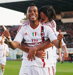 Robinho of Milan celebrates with a teammate after scoring the opening goal during the Serie A match between against Catania Calcio at Stadio Angelo Massimino on Saturday