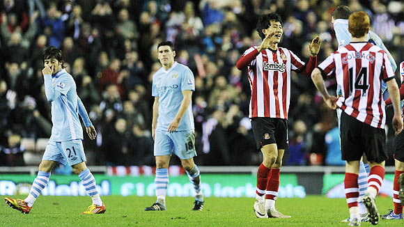 Sunderland's Ji Dong-won (centre) reacts after their English Premier League soccer match against Manchester City in Sunderland