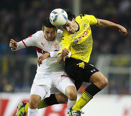 Borussia Dortmund's Hummels and Stuttgart's Ibisevic head a ball during their Bundesliga match in Dortmund