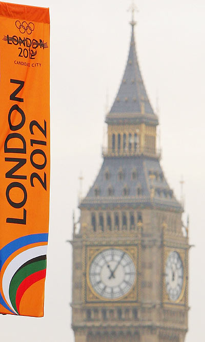A London 2012 banner flutters in the wind with Big Ben in the background