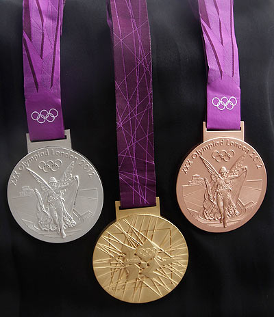 The 2012 Olympic games medals, designed by David Watkins, are unveiled