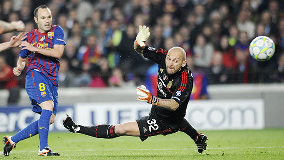 Barcelona's Iniesta scores a goal past AC Milan's goalkeeper Abbiati
