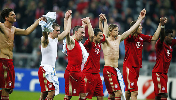 Players of Bayern Munich celebrate after their Champions League quarter-final second leg soccer match against Olympique Marseille in Munich