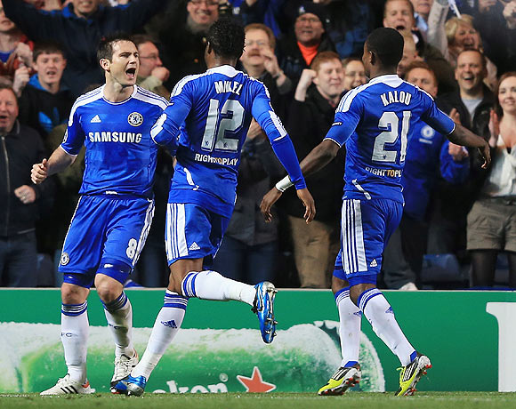 Frank Lampard (left) of Chelsea celebrates with team mates after scoring a penalty during their quarter-final agianst Benfica on Wednesday
