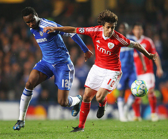 Pablo Aimar of Benfica is closed down by Chelsea's Mikel as their vie for possession during their match on Wednesday