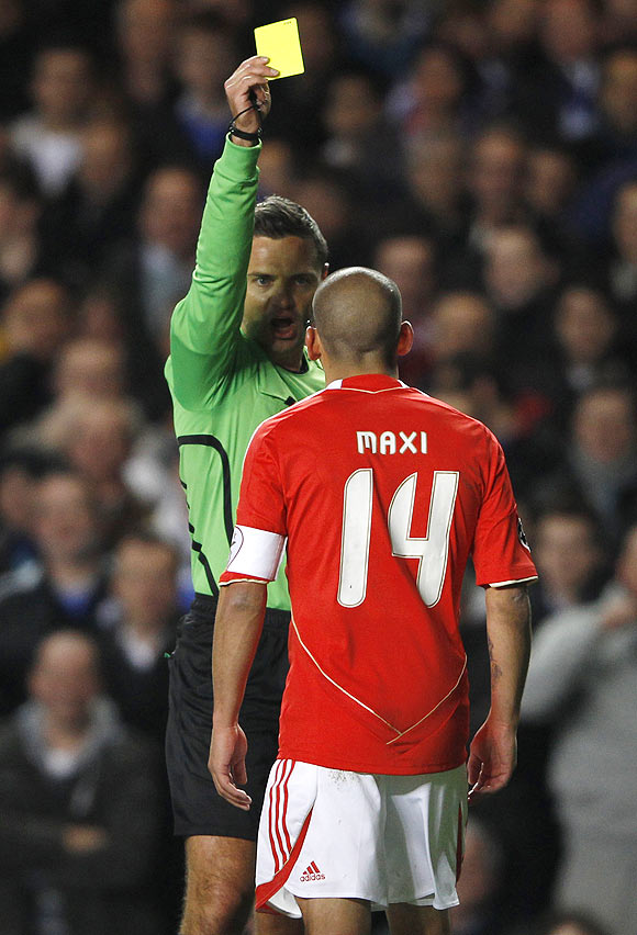 Benfica's Maxi Pereira is shown the yellow card during their Champions League match against Chelsea on Wedneday