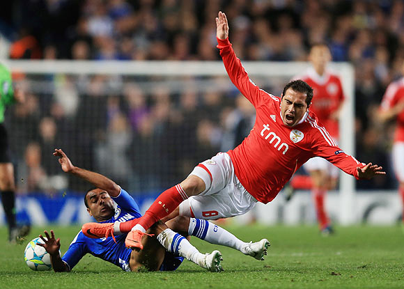 Chelsea's Ashley Cole challenges Benfica's Bruno Cesar during their match on Wednesday