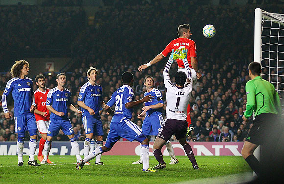 Benfica's Javi Garcia heads to score against Chelsea on Wedneday