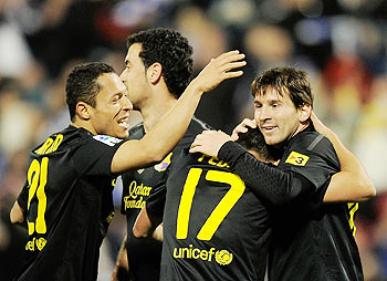 Lionel Messi (right) and Alexis Sanchez (left) of FC Barcelona congratulate Pedro Rodriguez (No.17) after Rodriguez scored Barcelona's 4th goal