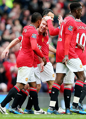 Paul Scholes of Manchester United is congratulated by his team-mates