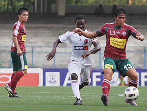 Surkumar (right) of Mohun Bagan goes past Lajong player as Sunil Chettri looks on