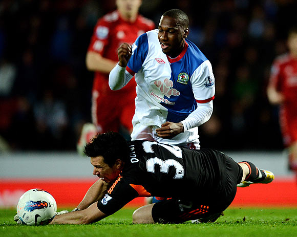 Liverpool's Alexander Doni brings down Junior Hoilett of Blackburn Rovers to concede a penalty