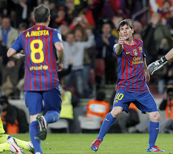 Barcelona's Lionel Messi (right) and Andres Iniesta celebrate a goal against Getafe