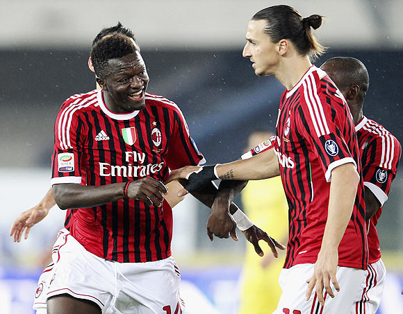 AC Milan's Sulley Muntari (left) celebrates with his teammate Zlatan Ibrahimovic after scoring against Chievo Verona