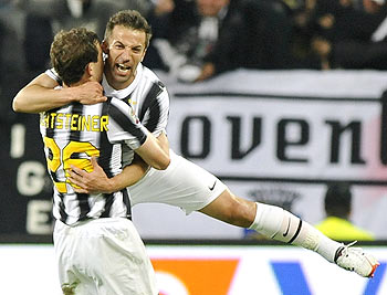 Juventus' Alessandro Del Piero (right) celebrates with teammate Stephan Lichtsteiner after scoring against Lazio on Wednesday