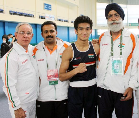 Left to right: Indian boxing team coach Blas Fernandez, physiotherapist Hari Shankar Varma, Shiva Thapa and coach Gurbax Singh Sandhu.