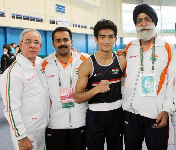Left to right: Indian boxing team coach Blas Fernandez, physiotherapist Hari Shankar Varma, Shiva Thapa and coach Gurbax Singh Sandhu.
