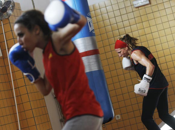 Spanish boxer Jennifer Miranda (right) and fellow boxer Yasmina Musa train
