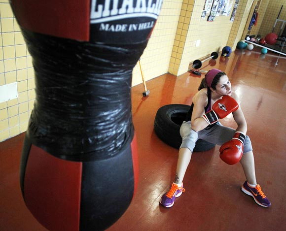Spanish boxer Marta Branas takes a moment to rest during a training session