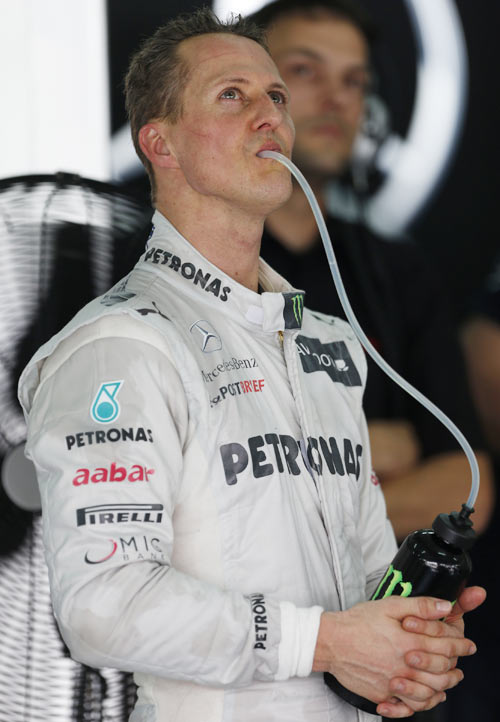 Mercedes Formula One driver Michael Schumacher of Germany looks at monitor
