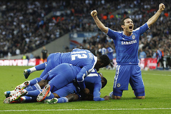 Chelsea's Frank Lampard (right) celebrates as his teammates jump on Ramires after he scored the winner during their FA Cup semi-final against Tottenham Hotspur at Wembley Stadium on Sunday