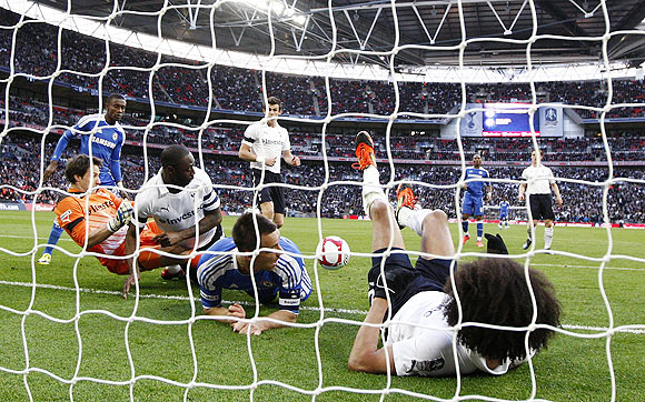 Chelsea and Tottenham Hotspur players block a shot from Chelsea's Juan Mata, which was controversially awarded as a goal, during their FA Cup semi-final on Sunday