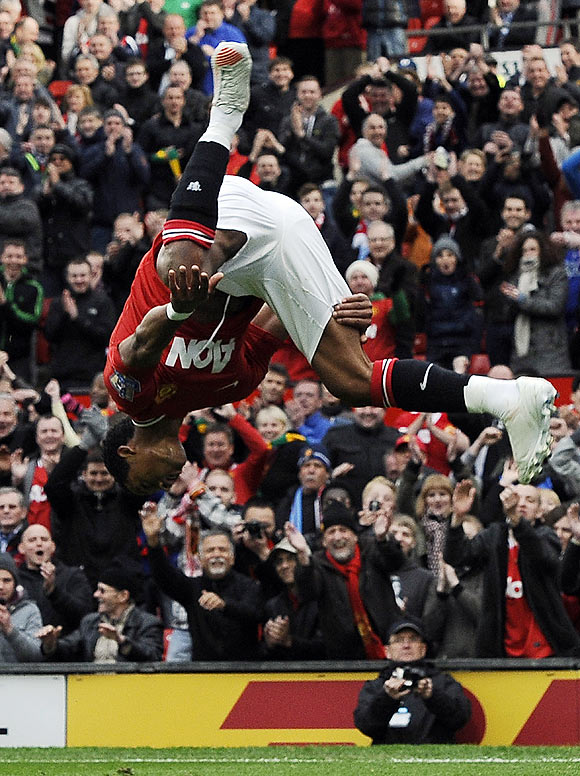 Manchester United's Nani does a somersault in celebration after scoring against Aston Villa during their Premier League match on Sunday