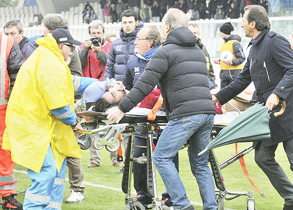Livorno's Piermario Morosini is helped by doctors as he is carried on a stretcher during their Serie B soccer match against Pescara at the Adriatico stadium in Pescara on Saturday