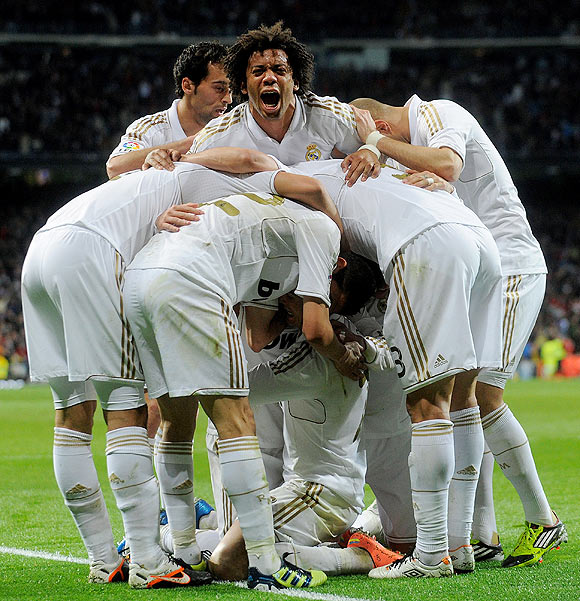 Real Madrid's players celebrate after Cristiano Ronaldo scored a goal on Sunday
