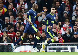 Jordi Gomez of Wigan celebrates with teammate Emmerson Boyce after scoring against Arsenal on Monday