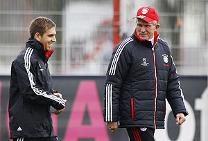 Bayern Munich's coach Jupp Heynckes (right) and Philipp Lahm arrive for a training session in Munich on Monday
