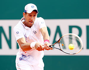 Serbia's Novak Djokovic plays a backhand against Italy's Andreas Seppi during the Monte Carlo Masters on Wednesday