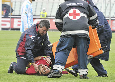 Piermario Morosini is attended to by medics after collapsing on the field on Saturday