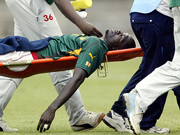 Marc-Vivien Foe is stretchered off the field