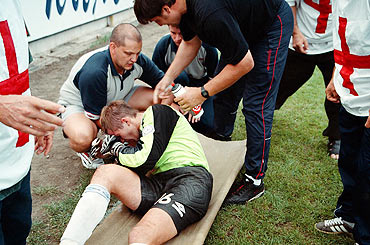 Serhiy Perkhun is tended to by medics after his clash with an opponent