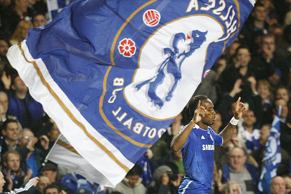 Drogba of Chelsea celebrates scoring against Barcelona