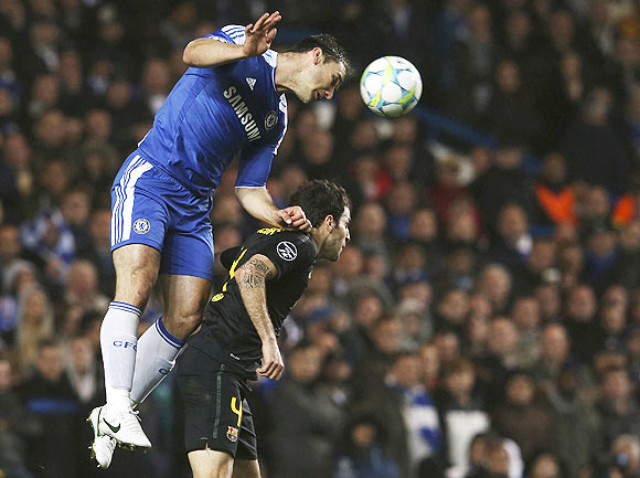 Ivanovic of Chelsea outjumps Fabregas of Barcelona